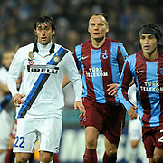 Trabzonspor's Gustavo COLMAN (R) and Inter's Diego MILITO (L) during their UEFA Champions League group stage matchday 5 soccer match Trabzonspor between Inter at the Avni Aker Stadium at Trabzon Turkey on Tuesday, 22 November 2011. Photo by TURKPIX