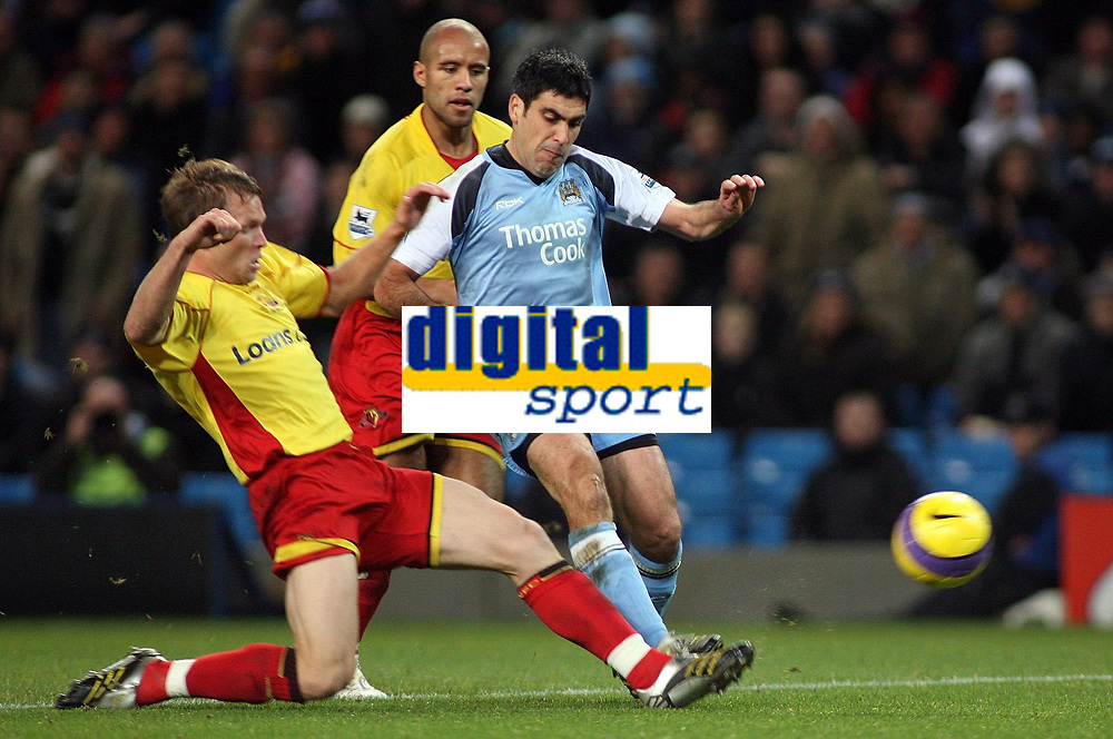 Photo: Paul Thomas.<br /> Manchester City v Watford. The Barclays Premiership. 04/12/2006.<br /> <br /> Claudio Reyna (R) of Man City shoots for goal in a Jay Demerit tackle (L).