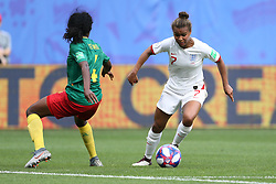 Cameroon's Yvonne Leuko (left) and England's Nikita Parris battle for the ball during the FIFA Women's World Cup, round of Sixteen match at State du Hainaut, Valenciennes.
