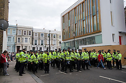 © Licensed to London News Pictures. 29/08/2011. London, UK. Heavy police presence on day 2 of the 2011 notting Hill Carnival today (29/08/2011) the second largest street festival in the world after the Rio Carnival held in Brazil . Photo credit: Ben Cawthra/LNP