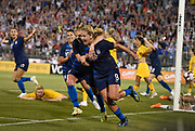 United States' Lindsey Horan (9) is hugged by teammate McCall Zerboni after scoring a goal during a women's international soccer match against Australia, Sunday, July 29, 2018, in East Hartford, Conn. (AP Photo/Jessica Hill)
