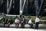 At the exterior of the Leadenhall Building, office and city workers enjoy the sunshine in the newly refurbished square, surrounded by new high rise modern architecture in the City of London, England, United Kingdom. As Londons financial district grows in height, the classical buildings are being dwarfed by the towers of glass.