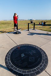 Viewing machines and people watching planes at Founders Plaza, DFW Airport, Texas, USA.