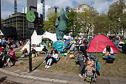 Climate change activists from the Extinction Rebellion group at the Marble Arch camp in protest that the government is not doing enough to avoid catastrophic climate change and to demand the government take radical action to save the planet, on 24th April 2019 in London, England, United Kingdom. Extinction Rebellion is a climate change group started in 2018 and has gained a huge following of people committed to peaceful protests.