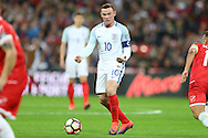 Wayne Rooney, the England captain in action as he directs play from midfield. FIFA World cup qualifying match, european group F, England v Malta at Wembley Stadium in London on Saturday 8th October 2016.<br /> pic by John Patrick Fletcher, Andrew Orchard sports photography.