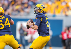 Oct 2, 2021; Morgantown, West Virginia, USA; West Virginia Mountaineers quarterback Jarret Doege (2) drops back for a pass during the first quarter against the Texas Tech Red Raiders at Mountaineer Field at Milan Puskar Stadium. Mandatory Credit: Ben Queen-USA TODAY Sports