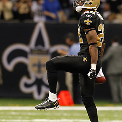 December 4, 2011; New Orleans, LA, USA; New Orleans Saints cornerback Tracy Porter (22) celebrates an interception against the Detroit Lions during the second half of a game at the Mercedes-Benz Superdome. The Saints defeated the Lions 31-17. Mandatory Credit: Derick E. Hingle-US PRESSWIRE
