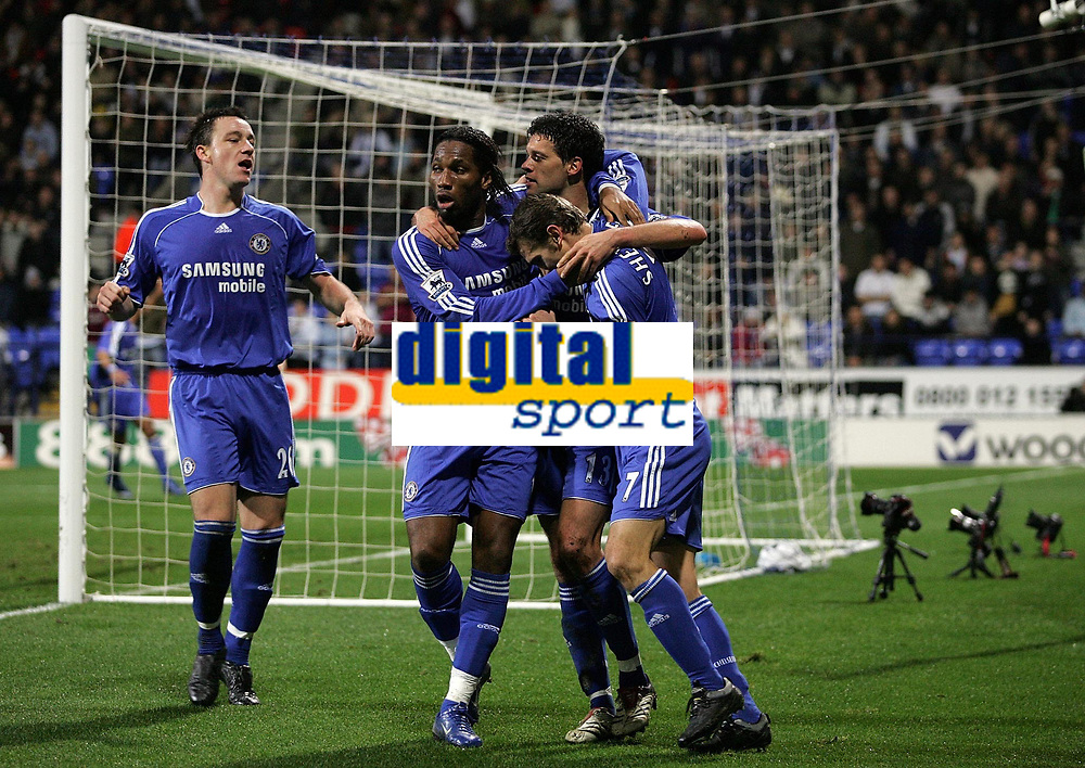 Photo: Paul Thomas.<br /> Bolton Wanderers v Chelsea. The Barclays Premiership. 29/11/2006.<br /> <br /> Goal scorer Michael Ballack (C) of Chelsea is congratulated by Didier Drogba (L) and Andriy Shevchenko (R) and captain John Terry (Far L).
