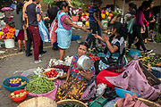 Am indigenous woman selling vegetables in the Municipal Market in Antigua, Guatemala.