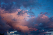 Pink clouds against a blue sky