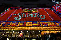 Jumbo Pachinko is well known as a classic pachinko parlor.  In modern Japan, pachinko places are often not appreciated by the neighbors because of the loud noise, and garish colors from the old style of parlour.  Updated pachinko parlors now usually resemble swank shopping malls or generic buildings so as to blend in more with the neibhorhood.  Still, some of the old style neon pachinko parlours remain.  One of the most famous is Jumbo Pachinko in Shinjuku.  Think: garish blinking lights, overwhelming noise, zombies like customers and players.