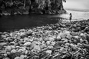 Native Hawaiian on the shore, Hilo, Hawaii.