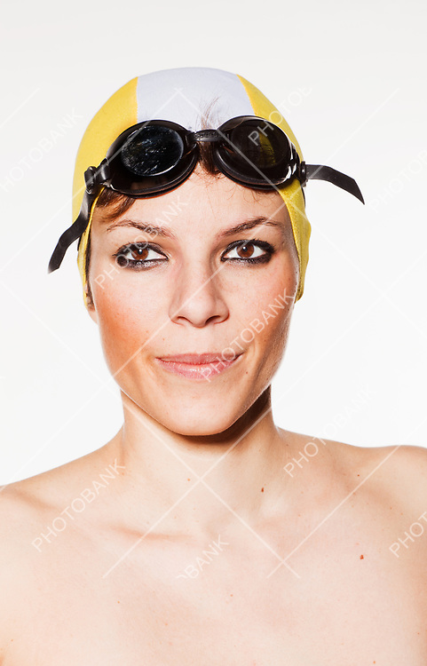 portrait of girl with cap and goggles for swimming, she is alone