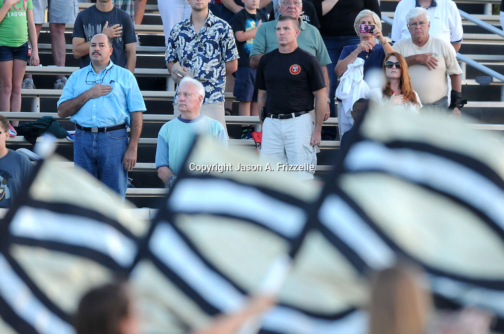 Spectators observe the National Anthem before the Topsail vs Pender football game Friday August 30, 2013 at Topsail High School. (Jason A. Frizzelle) This collection of images is from the 2013 High School Football in the Cape Fear region.