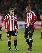 Billy Sharp of Sheffield Utd and Leon Clarke of Sheffield Utd during the English League One match at Bramall Lane Stadium, Sheffield. Picture date: December 26th, 2016. Pic Simon Bellis/Sportimage