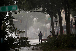 A man walks down Las Olas Boulevard in downtown Fort Lauderdale, FL, USA with downed trees all around as Hurricane Irma continues to batter South Florida on Sunday, September 10, 2017. Photo by Amy Beth Bennett/Sun Sentinel/TNS/ABACAPRESS.COM