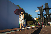 Lady walking at Dashanzi Art District, also know as 798