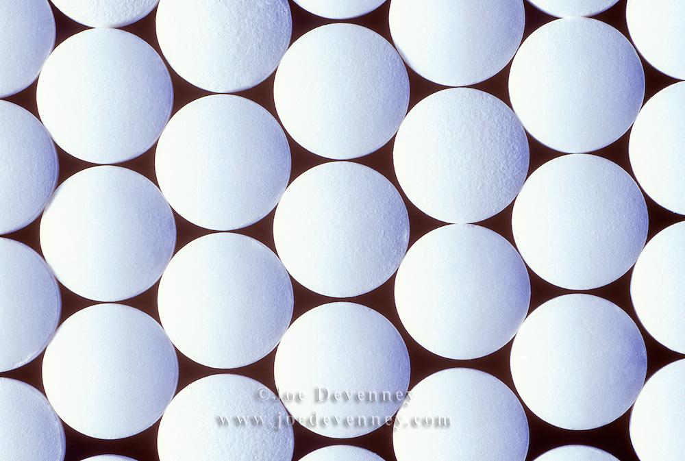 Apirins arranged in a pattern