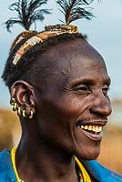 Head piece signifies this Dassanach tribe man as a village elder, Omo Valley, Ethiopia.