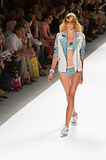 Two piece swimsuit with lace trimmed bottom and matching jacket. By Custo Barcelona at the Spring 2013 Fashion Week show in New York.