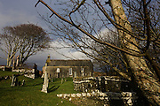 The old church at Kilninian (built 1755, ten years after the Jacobite Rising)  but the site of worship with medieval tombstones dating from the 14th century, Kilninian, Isle of Mull, Scotland. church is one of the oldest, and until very recently, still used for worship.   Possibly standing on the site of an earlier medieval church, it first appears in the records of 1561, where it is stated that the parsonage of 'Keilnoening' had formerly belonged to the Abbot of Iona, one-third of the revenues going to the Bishop of the Isles as was customary in the diocese. Iona Abbey would have appointed a minister for the church at a stipend lower than the tithes. It is uncertain whether the church was dedicated to St Ninian, the apostle of Galloway, or to a local saint of the Early Christian period'.   It is also believed to have been once known as the Chapel of the Nine Maidens and in Gaelic  'Cill Naoi Nighean', although another possible name was The Church of the Holy Maidens - 'Cill Naoimh Nighean...(http://www.undiscoveredscotland.co.uk/mull/kilninianchurch/index.html)