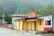 A roadside bar, Cantina flor del cafe, coffee flower, with beer posters.. San Juan la Laguna. Departamente de Sololá, Republic of Guatemala. 06Mar14