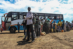 A bus of refugees arrives from Kuluba reception centre to BidiBidi settlement. More than 300,000 South Sudanese refugees have fled from the country's civil war into Uganda since fighting broke out in July. They mostly travel by foot for days through the bush as roads have been blocked or are too dangerous to cross. The massive influx of refugees has caused a strain in humanitarian aid due to large numbers and lack of funding. BidiBidi settlement is now the third largest in the world and holds more than 210,000 people since its opening in September.