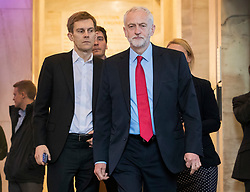 © Licensed to London News Pictures. 11/05/2017. London, UK. Jeremy Corbyn is followed by his advisors Seumas Milne (L) and James Schneider (2L) as he leaves the building to face reporters waiting outside a Labour Party clause IV meeting held to discuss the Labour Party general election manifesto.   A draft of the Labour election manifesto had been leaked to two national newspapers. Photo credit: Peter Macdiarmid/LNP