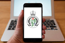 Using iPhone smartphone to display logo of The Supreme Court , UK Government