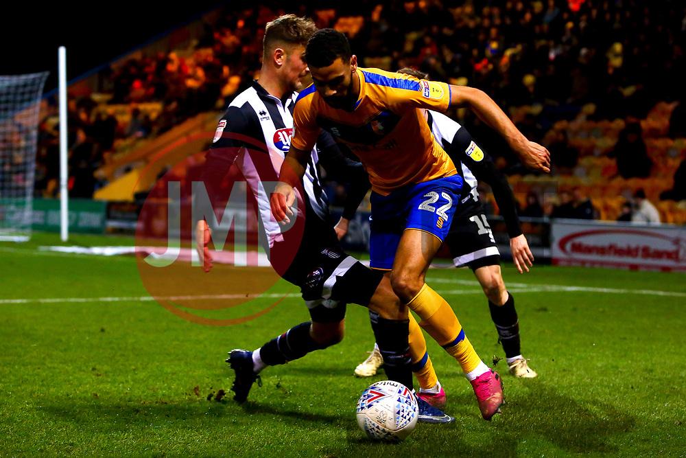 Luke Hendrie of Grimsby Town tackles CJ Hamilton of Mansfield Town - Mandatory by-line: Ryan Crockett/JMP - 04/01/2020 - FOOTBALL - One Call Stadium - Mansfield, England - Mansfield Town v Grimsby Town - Sky Bet League Two