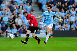 Manchester United's Wayne Rooney is closed down by Manchester City's Samir Nasri - Photo mandatory by-line: Dougie Allward/JMP - Tel: Mobile: 07966 386802 22/09/2013 - SPORT - FOOTBALL - City of Manchester Stadium - Manchester - Manchester City V Manchester United - Barclays Premier League