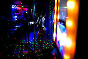 In this photo taken May 5, 2011, a sex worker dances as she waits for customers at Vila Mimosa prostitution zone in Rio de Janeiro, Brazil. <br /> <br /> Spelling the possible end of Vila Mimosa is a high-speed train the government wants to build to link Rio to Sao Paulo, as part of Brazil's Olympic proposal. The government is expected to open bidding to prospective builders July 29.