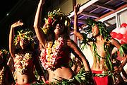 Traditional French Polynesian dancers playing at a local fete, dancing with grass skirts to South Pacific rythms, Papeete, Tahati, French Polynesia<br /> <br /> Un nouveau regard sur la Polynesie Francaise. Dynamisation, collaborations, innovation, developpment resources, economie, entreprises et organismes polyesiennes, endemisme terrestre et marin, biodiversite, biomolecules, biotechnologies, endemisme terrestre et marin, energies renouvelables, preservation durables, climat tropical, alternatives a l'utilisation de produits chimiques, transformation agroalimentaires, usages traditionnels des plantes, utilisation des plantes endemiques en cosmetique et en medecine, aquaculture performante et durable, valorisation des dechets, outre mer et la zone pacifique, technologies innovantes, synergies, culture, traditions, technologique et scientifique, collaborations, stimulation, production et realization, protection, transformation, diversite, pharmocopee, experimentation, autonomie, espace naturels et eco-tourisme,