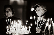 Women light candles at an Orthodox church in Tbilisi, Soviet Georgia