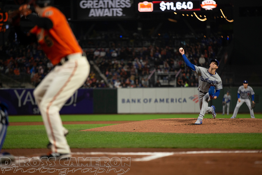 Sep 27, 2019; San Francisco, CA, USA; Los Angeles Dodgers starting pitcher Walker Buehler (21) delivers against the San Francisco Giants during the first inning of a baseball game at Oracle Park. Mandatory Credit: D. Ross Cameron-USA TODAY Sports