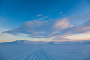 A UNIS student on a class field trip returning from Tunabreen travels by snowmobile across Fimbulisen, Svalbard.