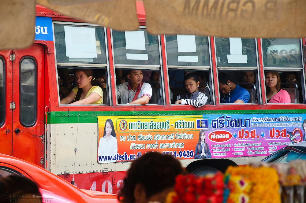 Comuters riding a bus, Bangkok, Thailand