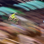 A blur of motion as a competitor flies through the air during the Monster Energy AMA Supercross series held at MetLife Stadium. 62,217 fans attended the event held for the first time at MetLife Stadium, New Jersey, USA. 26th April 2014. Photo Tim Clayton