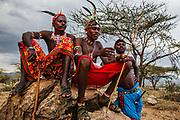 Portrait of Samburu warriors posing on a rock,Samburu, Kenya, Africa