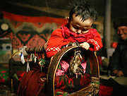 Qydel Nissa, born winter 2007, has an eagle head on her cradle, to keep bad spirits away..Campment of Ortobil (Sufi), all the way at the end of the Little Pamir, near the Tajik/China border. .Winter expedition through the Wakhan Corridor and into the Afghan Pamir mountains, to document the life of the Afghan Kyrgyz tribe. January/February 2008. Afghanistan