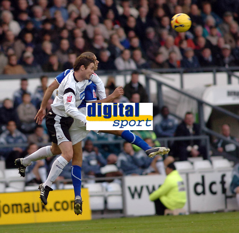 Photo: Kevin Poolman.<br />Derby County v Leicester City. Coca Cola Championship. 25/11/2006. Matt Oakley of Derby and Patrick Kisnorbo of Leicester both go up for the ball.