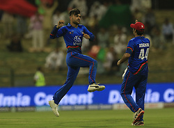 September 17, 2018 - Abu Dhabi, United Arab Emirates - Afghanistan cricketer Rashid Khan celebrates after taking a wicket during the 3rd cricket match of Asia Cup 2018 between Sri Lanka and Afghanistan at the Sheikh Zayed Stadium,Abu Dhabi, United Arab Emirates. 09-17-2018  (Credit Image: © Tharaka Basnayaka/NurPhoto/ZUMA Press)