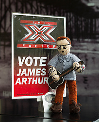 © Licensed to London News Pictures. 26/10/2012..Saltburn, Cleveland, England..Knitted James Arthur figure in Rapps Cafe in Saltburn...The Saltburn 'Yarnbombers' have struck again in the Cleveland seaside town of Saltburn by the Sea. This time, their target is the X Factor star James Arthur who comes from the Saltburn.. Two locations within the town each received an anonymous package in the post containing a knitted representation of the singer..The Rapps cafe and the Victoria pub each received a figure because of the huge support they offer the singer...An X Factor pizza menu is available at Rapps offering such delights as Nicole Chef-Zinger whilst the Victoria Pub screens each show live to a packed bar...Photo credit : Ian Forsyth/LNP
