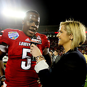 Louisville Cardinals quarterback Teddy Bridgewater (5) gets interviewed by ESPN on the field after the NCAA Football Russell Athletic Bowl football game between the Louisville Cardinals and the Miami Hurricanes, at the Florida Citrus Bowl on Saturday, December 28, 2013 in Orlando, Florida. Louisville won the game by a score of 36-9. (AP Photo/Alex Menendez)