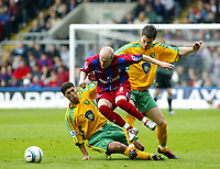 Photo. Chris Ratcliffe<br /> Crystal Palace v Norwich City. Barclays Premiership. 16/04/2005<br /> Andy Johnson of Palace skips away from the challenge of Youssef Safri left, and Jason Shackell of Norwich