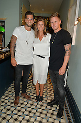 Left to right, cricketer JADE DERNBACH, LARA CRABB and cricketer JASON ROY at the launch of Give Me Sport Magazine held at Library, 112 St.Martin's Lane, London on 30th July 2014.