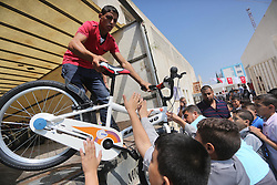 September 17, 2016 - Gaza City, Gaza Strip, Palestinian Territory - Palestinian orphan student receive bicycles from Turkish aid ''clips'', in Gaza City, on Sept. 17, 2016  (Credit Image: © Mohammed Asad/APA Images via ZUMA Wire)