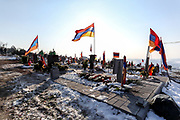 Multiple Armenian national flags are seen waving over the graves of the fallen soldiers at the Yerablur cemeteries on Sunday, Dec 27, 2020. Yerablur is otherwise known as the Armenian Military Pantheon that is a military cemetery located on a hilltop in the outskirts of capital Yerevan. The hilltop of Yerablur has become the burial place of Armenian soldiers who lost their lives during the Nagorno-Karabakh conflict since 1988.<br /> According to official figures released by the belligerents, Armenia lost 2,996 troops in the 44 days of 2020 war in Nagorno Karabakh. (Photo/ Vudi Xhymshiti)