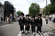 A small group of orthodox Jews show their support for the Stop the Siege demonstration.<br /> <br /> Tens of thousands of protesters marched in Central London to show their outrage against the Israeli onslaught on Gaza.