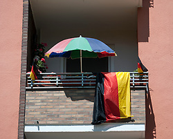 balcony with German flag and parasol during football World Cup 2010 in Berlin Germany